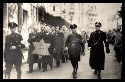 Bilden kommer från svenska Wikipedia och den text om nazism som finns där. På bilden syns judar som tvingas bära en davidstjärna i samband med Kristallnatten 10 november 1938.
